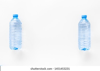 Plastic bottles with pure water on white background top view space for text