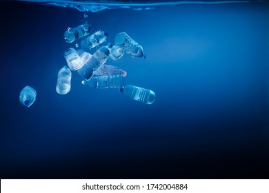 Plastic bottles sinking in to the ocean. Enviromental polution concept. World ocaens day