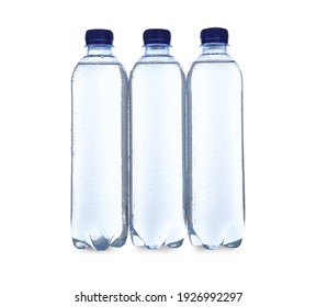 Plastic bottles with soda water on white background