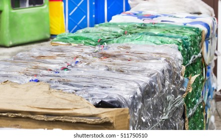 Plastic bottles of various products - compacted for recycling - industrial reuse - ecological