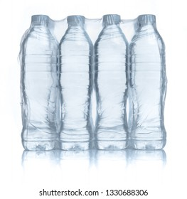 Plastic bottles water in wrapped package on white background