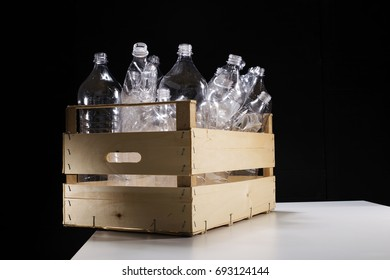 Plastic bottles in wood crate, waste recycle and segregation