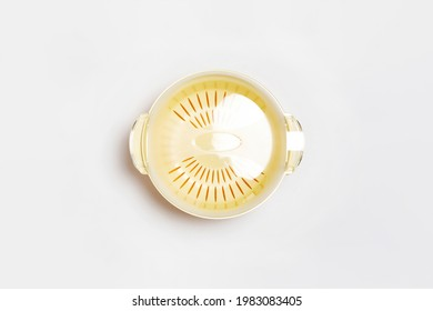 Plastic bowl with a colander on a white background. Sieve, colander, fruit, and vegetable bowl.High-resolution photo.