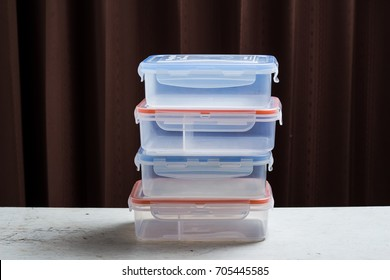 plastic box for food storage on the wooden