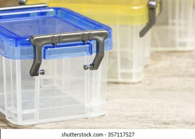 Plastic box on wooden background,close up view.