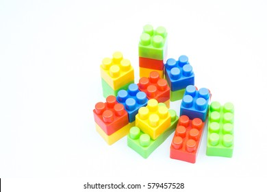 Plastic building block on white isolated background