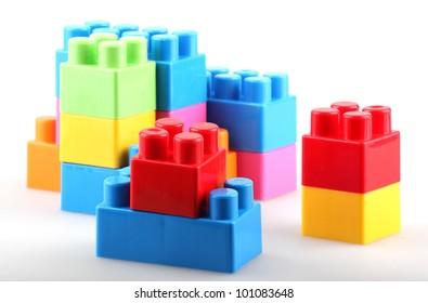 Plastic building blocks isolated on white background.