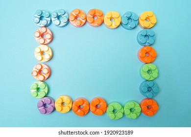 Plastic building blocks isolated on blue background. Top view with copy space