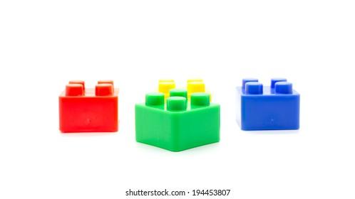 Plastic building blocks isolated on white background