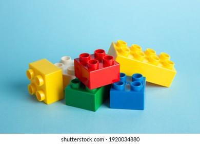 Plastic building blocks on blue background