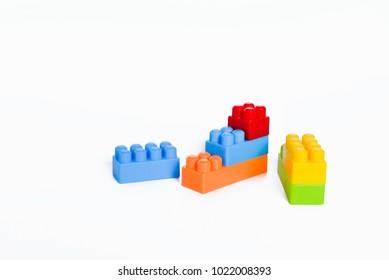Plastic building blocks on white isolated background.