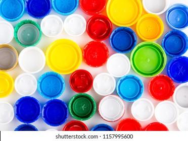 Plastic caps as background. Colored bottle caps texture.