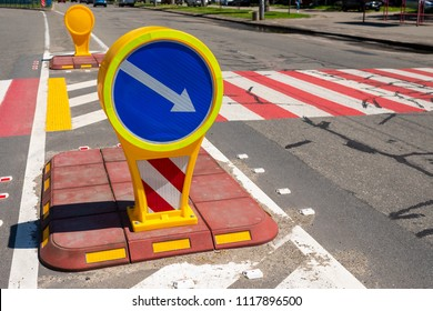 plastic car sign near a pedestrian crossing on the road on a sunny day