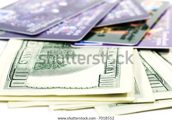 Plastic cards and paper dollars