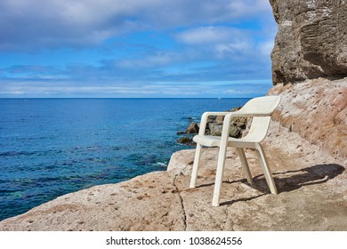 Plastic Chair with nice view at Seaside / Leisure at rocky beach of Mogan on Grand Canary Island
