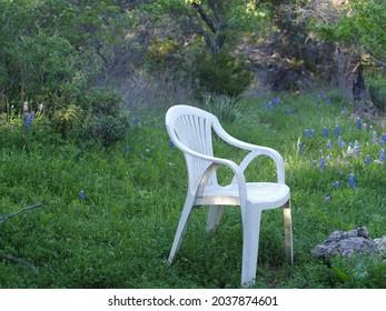 A plastic chair on the ranch, Spicewood, Burnet County, Texas, USA. Stolen land of the Mumunuu, Coahuiltecan, Nde Konitsaaii Gokiyaa, Tokawa, Jumanos