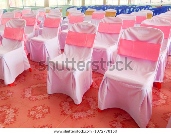 Outstanding Plastic Chairs Cover White Cloth Pink Stock Photo Edit Now Lamtechconsult Wood Chair Design Ideas Lamtechconsultcom