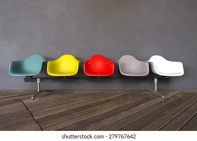 Plastic chairs isolated on gray background and wooden floor