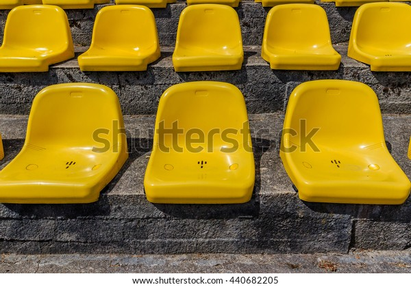 Plastic chairs in  sports arena