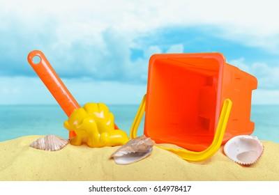 Plastic children toys on the sand beach