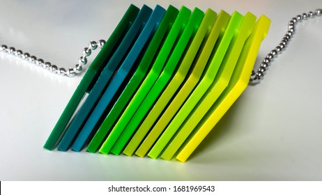 Plastic color swatches book. Sample colors catalogue for plastic products. Color Guide Book. Color palette. Color shade chart. Green colors