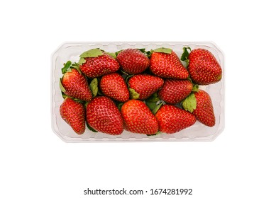 Plastic container with strawberries isolated on a white background. Fresh and ripe summer berries in the package. Top view, flat lay.