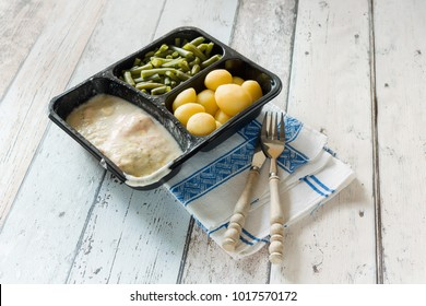 Plastic container with unhealthy and unappealing tv dinner