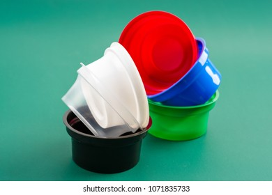Plastic containers for food liquids and sauces in shops and for counters