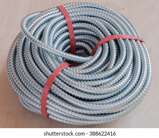 Plastic corrugated pipe  on the wooden floor.