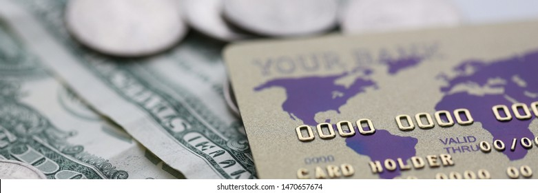 Plastic credit card and dollars cash with coin lie on table. Fast money transaction concept.