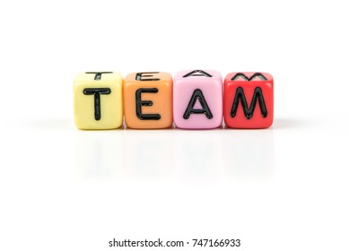Plastic cube letter of word TEAM isolated on white background