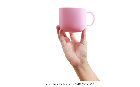 Plastic cup in a hand holding