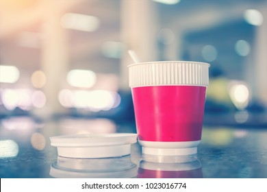 plastic cup with hot instant coffee  on blurred background,, selective focus and vintage filter