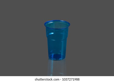 Plastic cups on a gray background
