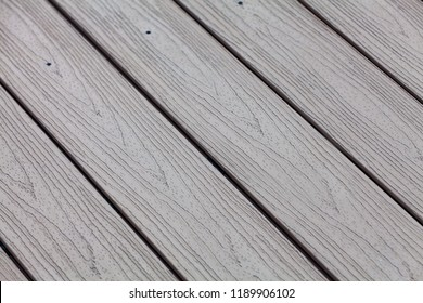 Plastic decking boards with wood decor structure