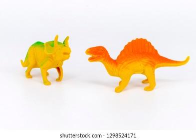 Plastic dinosaur toy on white background. Selective focus.