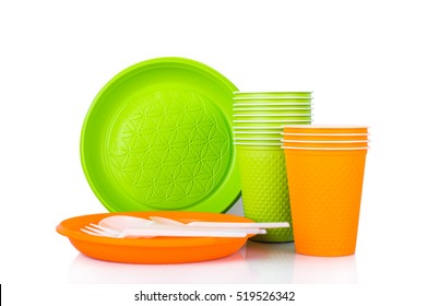 Plastic disposable dishes on a white background