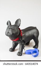 Plastic dog mannequin with dog tape collar in red and blue roulette lead