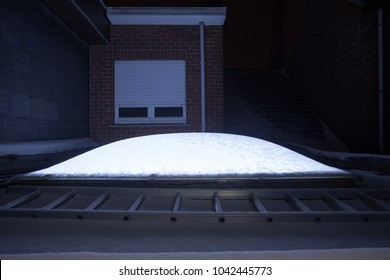 Plastic Dome of a row house on a flat roof whit snow