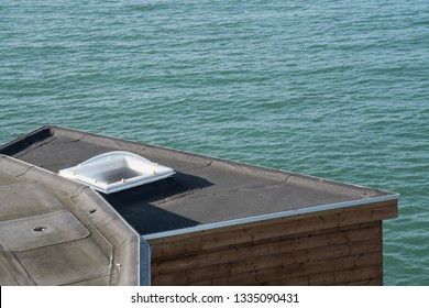Plastic Dome of a row house on a flat roof at the sea