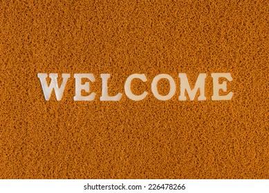 Plastic doormat and welcome word