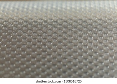 Plastic dot pattern in grey-silver colour. Abstract background of lots of grey pimples dots. Plastic surface with pimples