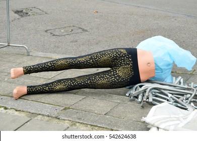Plastic dummy leg wearing a sleeping pants on the floor