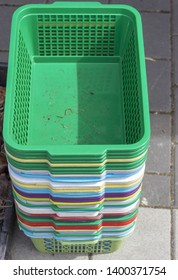 Plastic empty colored green white yellow blue red boxes for flowers