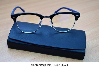 plastic eyeglasses for poor vision on the optical instrument case on the table