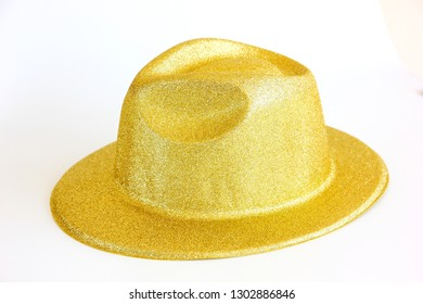 plastic fancy hat decorated in gold on white background