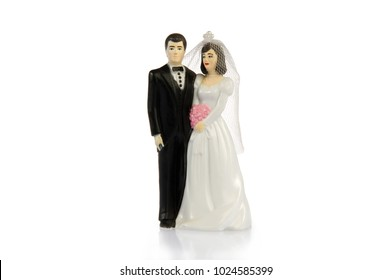 A plastic figurine of a married couple