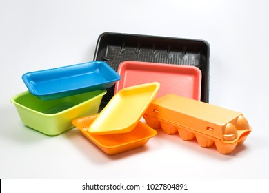 plastic food trays on a gray background