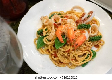 plastic food for window display. Spaghetti seafood with soft focus on prawns, a replica of a real food for display in front of the restaurant. (fake food display)