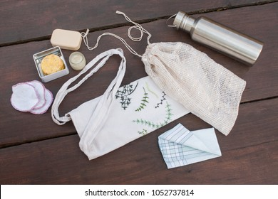 Plastic free, zero waste shopping and living. Reusable, recycled, homemade produce bag for fruit or vegetables, a textile bag, a stainless steel bottle, handkerchief, homemade lavender cream and soap.